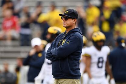 Coach Jim Harbaugh of the Michigan Wolverines watches action before a game against the Wisconsin Badgers at Camp Randall Stadium on September 21, 2019 in Madison, Wisconsin.
