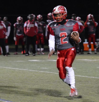 Edgewood quarterback Antwan Banks tucks the ball and sprints up the field looking for some room to run during last year's game against Havre de Grace.