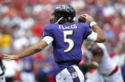 Ravens quarterback Joe Flacco drops back to pass during the third quarter of their game against the Tampa Bay Buccaneers.