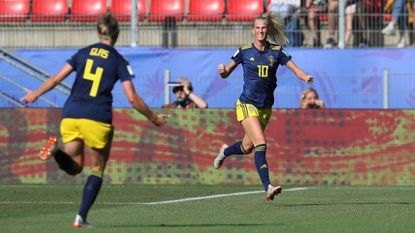 Sweden's Sofia Jakobsson, right, celebrates with teammate Hanna Glas after scoring her side's first goal during the of the Women's World Cup quarterfinal soccer match between Germany and Sweden at Roazhon Park in Rennes, France, Saturday, June 29, 2019.