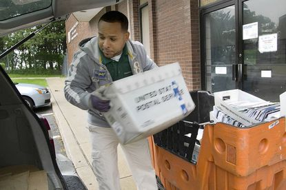 Carlos Mateo picks up mail from the Waverly post office every weekday for Union Memorial Hospital, where he works.