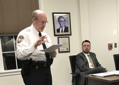 East Hampton, Conn., Police Chief Dennis Woessner addresses the Town Council in East Hampton. East Hampton officer Kevin P. Wilcox, has retired from the force after Committee for Civil Rights Under Law raised concerns about his membership with the Proud Boys.