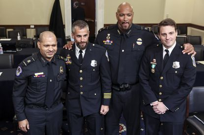 In this July 27, 2021 photo, from left, U.S. Capitol Police Sgt. Aquilino Gonell, Washington Metropolitan Police Department officer Michael Fanone, U.S. Capitol Police Sgt. Harry Dunn and Washington Metropolitan Police Department officer Daniel Hodges pose for a photo after a House select committee hearing on the Jan. 6 attack on Capitol Hill in Washington. Oliver Contreras/The New York Times via AP, Pool)