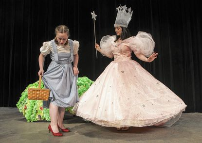 """Elise Starkey plays Dorothy and Stephanie Mahoney plays Glinda in Phoenix Festival Theater production of """"The Wizard of Oz"""" in Harford Community College's Chesapeake Theater on June 5, 6, 12 and 13 at 7 p.m. and June 7 & 14 at 2 p.m."""
