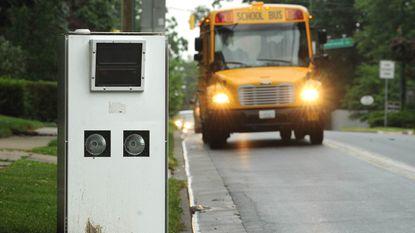 A Baltimore County public school bus approaches a speed camera near Stoneleigh Elementary.