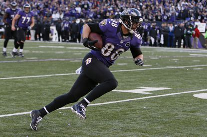 Ravens tight end Dennis Pitta runs after catch for a third quarter touchdown against the Indianapolis Colts.