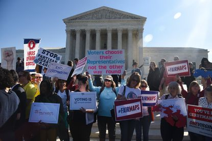 Demonstrators gather outside of the U.S. Supreme Court during an oral arguments in Gill v. Whitford to call for an end to partisan gerrymandering in Washington, D.C.