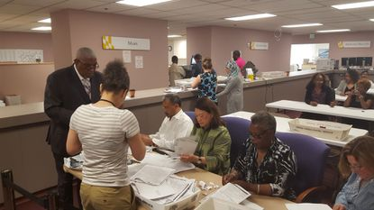 Baltimore City Board of Elections officials review ballots that were found during a state investigation of irregularities in the city's primary.