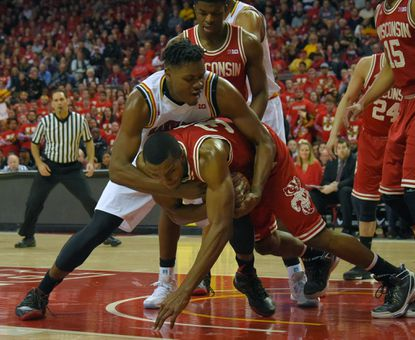 Maryland center Diamond Stone tangles with Wisconsin forward Vitto Brown late in the first half, leading to a technical foul on Stone.