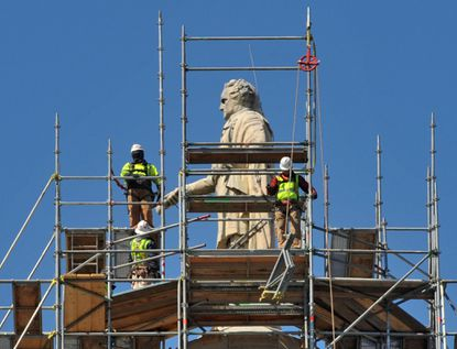 As restoration work on the Washington Monument continues, the scaffolding has reached George Washington's head. Workers are repairing and repointing the marble and brick inside and out, and expect to have the work completed before the monument's bicentennial on July 4, 2015.