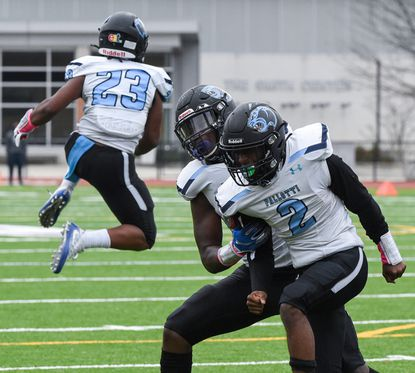 Pallotti's Kenneth Prince (2) and his teammates celebrate a touchdown during a double-overtime game against Mount Saint Joseph on Nov. 21, 2020.