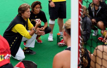 Maryland field hockey coach Missy Meharg speaks with her team after beating Michigan State.