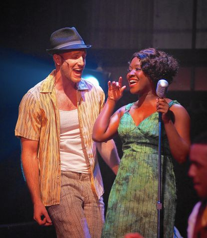 "Greg Twomey as Huey and Ashley Lauren Johnson as Felicia harmonize in a scene from ""Memphis"" at Toby's Dinner Theater."