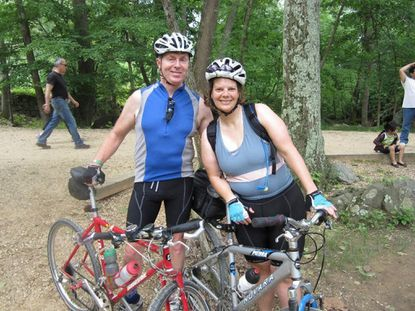 David Whitaker, left, and his wife Kim Lamphier pose for a photo on the Torrey C. Brown Trail in Baltimore County in 2012.
