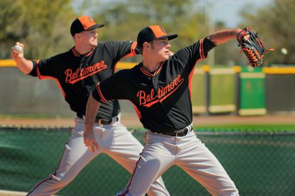 Tyler Wilson (right) throws with fellow pitching prospect Mike Wright during a spring training workout.