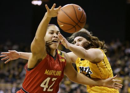 Maryland's Brionna Jones (Aberdeen) grabs the ball in front of Iowa's Megan Gustafson, right, during the second half.