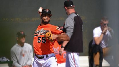 Orioles pitcher Dillon Tate throws a bullpen session at spring training.