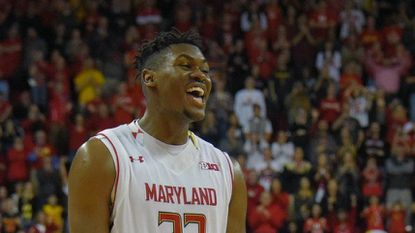 Former Terp Diamond Stone smiles with the game in hand after scoring 39 points against Penn State during the 2015-16 season.