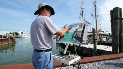 Artists work at their easels during the Artists Paint OC: Plein Air event sponsored by the Art League of Ocean City.