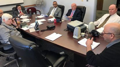Athan Sunderland, right, CEO of the Huntley Sports Group, talks with Aberdeen city leaders Monday about potential sticking points to putting on non-baseball events at Ripken Stadium.