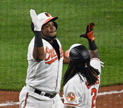 Orioles' Maikel Franco, left, high fives Freddy Galvis after Franco's three-runs homerun against the Mets in the fifth inning at Oriole Park at Camden Yards on June 8, 2021.