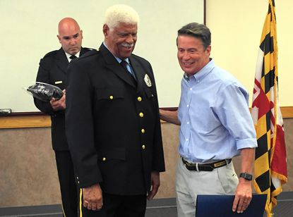 Richard Presberry, left, who was honored Saturday for his 45 years of service with the Bel Air Volunteer Fire Company, shares a laugh with Harford County Executive Barry Glassman. Bel Air Chief Rick Davis Jr. is in the background.