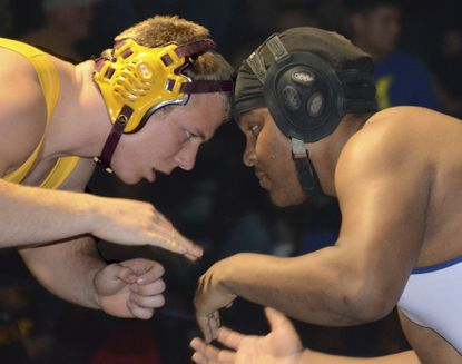 Catonsville's Calloway Lee lost 4-3 in sudden death in the 220-pound match at the Baltimore County tournament to Hereford's Brock Turnbaugh, but Lee earned an award for his integrity on the mat in an earlier match.