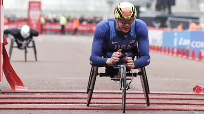 Daniel Romanchuk of the United States crosses the finish line to win fist place in the men's wheelchair race of the 39th London Marathon in London, Sunday, April 28, 2019.