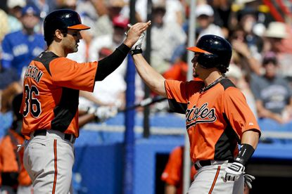 Conor Jackson (left) and Steve Pearce (right) are battling for the final bench spot on the Orioles' Opening Day 25-man roster.