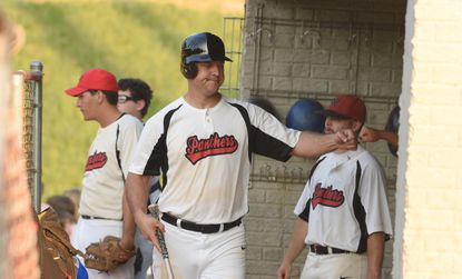 North Carroll's Jon Hill is congratulated by teammates after scoring a run during a South Penn Baseball League game against Littlestown in Manchester on Thursday, July 2.