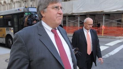 Thomas McDonough, one of the prosecutors in the trial of former Baltimore Mayor Sheila Dixon, is shown exiting court in 2009. McDonough is retiring after more than three decades in the prosecutor's office.