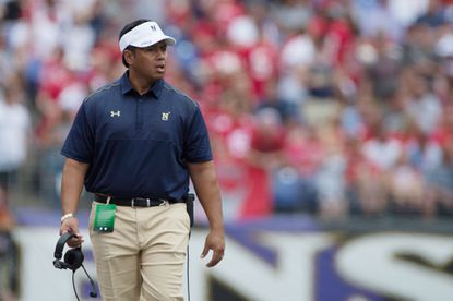 Navy coach Ken Niumatalolo paces the sideline during the first quarter.