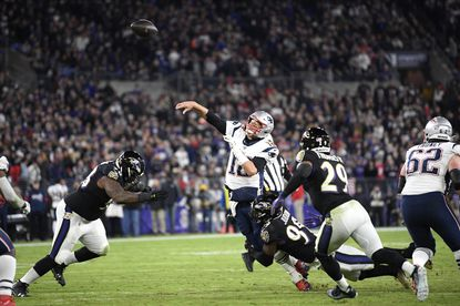 New England Patriots quarterback Tom Brady (12) throws a pass as he is hit by Baltimore Ravens linebacker Matthew Judon (99) during the first half of an NFL football game, Sunday, Nov. 3, 2019, in Baltimore. (AP Photo/Nick Wass)