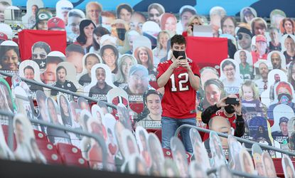 Bucs fans takes pictures among cardboard cutouts in the stands before the start of the Super Bowl LV game of Tampa Bay Buccaneers versus Kansas City Chiefs at Raymond James Stadium in Tampa, Florida, on Sunday, February 7, 2021. (Stephen M. Dowell/Orlando Sentinel)