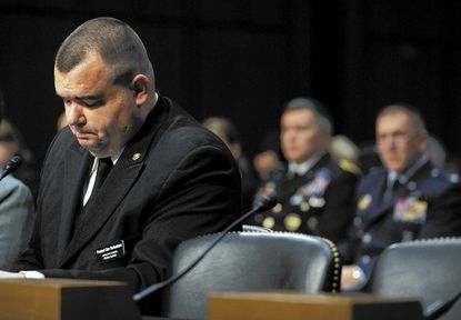 Brian Lewis, left, a former sailor in the U.S. Navy, testifies before the Subcommittee on Personnel of the United States Senate Committee on Armed Services about the sexual assault committed against him while in the service.
