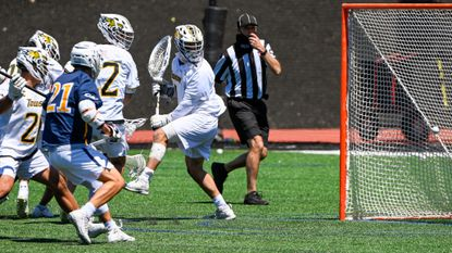 Drexel's Jack Mulcahy (5) scores the game-winning goal on Towson goalkeeper Shane Brennan (1) with only 11 seconds left 4th period. Drexel traveled to Towson to face the men's lacrosse team at Johnny Unitas Stadium on Saturday, May 1, 2021. The Dragons beat the Tigers, 12-11.