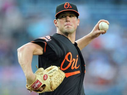 Baltimore Orioles starting pitcher Brian Matusz delivers a pitch against the Atlanta Braves in the first inning at Turner Field.