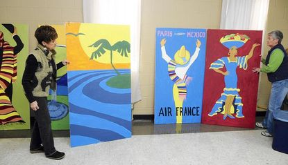 Pat Fair, left, and Carolyn Foley with the Havre de Grace Arts Commission, look over some of the painted panels before they put them away. The group decided this year's annual gala would be cancelled for first time in more than 20 years.