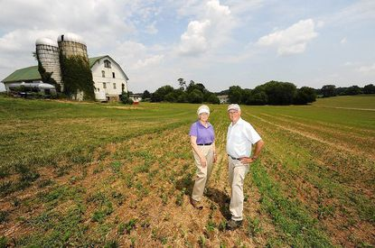 In 2012, Lambert and Marjorie Cissel pose for a portrait on their 180-acre farm in Lisbon.