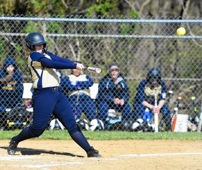 Perryville batter Carly White takes a big swing and puts the ball into play during a turn at the plate in Wednesday's game against visiting Harford Tech.