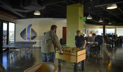 Employees have their choice of diversions including ping pong, and foosball at Visionist Inc. in Columbia.