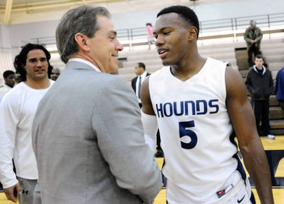 """Gilman football standout Cyrus Jones, right, greets University of Alabama head football coach Nick Saban after Gilman's 77-68 victory over Calvert Hall on the basketball court at the Finney Athletic Center in Roland Park. Jones is the Towson Times/Baltimore Messenger Athlete of the Year. <a href=""""http://www.baltimoresun.com/news/maryland/baltimore-county/towson/ph-ms-tt-cyrus-jones-athlete-of-year-0620-20120620,0,3547867.story"""">Read about the <i>Towson Times</i> and <i>Baltimore Messenger</i> Athlete of the Year here.</a>"""