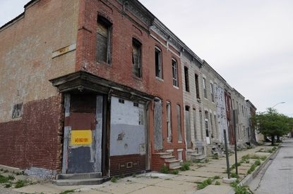A row of mostly vacant houses on part of the 500 block of Baker St. Baltimore now has an estimated 16,000 abandoned properties, about a fifth of them owned by the city.