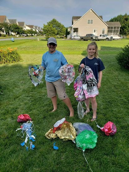 Siblings Josh, 13, and Emily Blume, 11, who organized a balloon contest clean up near their home in Berlin, Maryland, in the summer of 2018. - Original Credit:
