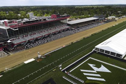A view of the grandstand and the finish line is seen at Pimlico Race Course ahead of the Preakness Stakes horse race, Tuesday, May 11, 2021, in Baltimore. (AP Photo/Julio Cortez)