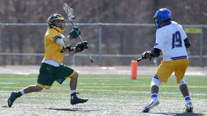 North Harford's Connor Diem makes a break toward the goal looking to take a shot as Aberdeen's Jordan Jenkins gets into position on defense during Monday afternoon's game at Aberdeen. Diem scored four goals in the Hawks win.