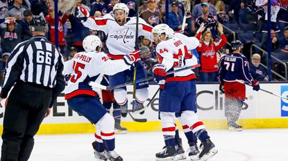 Brett Connolly, facing, of the Washington Capitals reacts after Lars Eller scored the winning goal against the Columbus Blue Jackets in double overtime in Game 3 of the NHL Eastern Conference quarterfinals Tuesday night at Nationwide Arena.