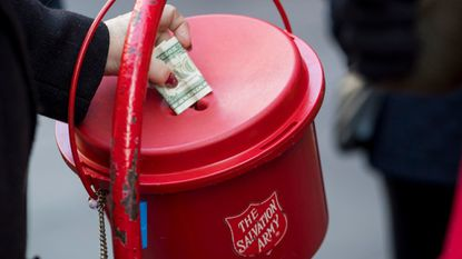 People donate to a Salvation Army collection bucket on Michigan Avenue in Chicago on Dec. 19.