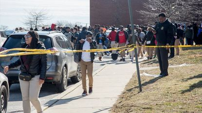Students at Frederick Douglass High School were evacuated after a 25-year-old man entered the school shortly after noon and shot a hall monitor.