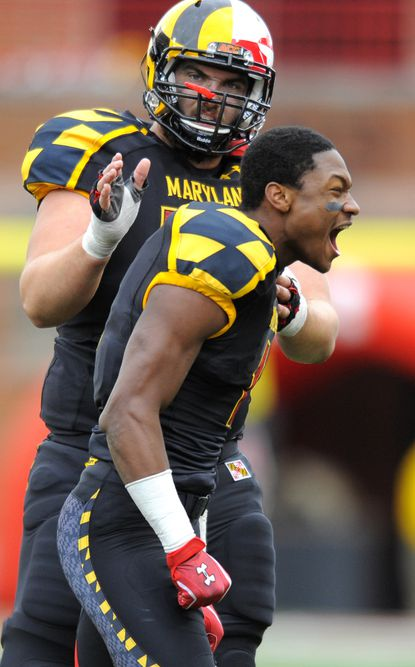 Terps receiver Stefon Diggs reacts after his third-quarter touchdown against Georgia Tech was upheld after replay. Teammate Justin Gilbert pats him on the back.